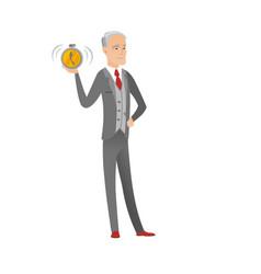 Senior caucasian businessman holding alarm clock vector
