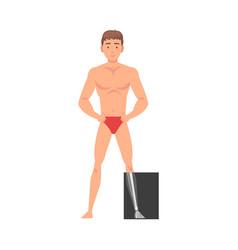 Young man standing in undershorts doing his leg vector