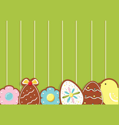 Easter background with cookies on green wooden vector