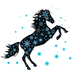 A silhouette of a horse with snowflakes vector image vector image