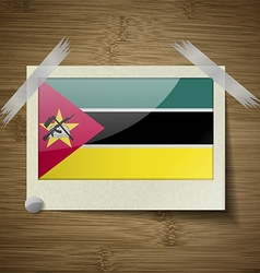 Flags Mozambique at frame on wooden texture vector image