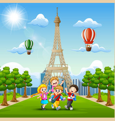 happy kids playing in front of eiffel tower backgr vector image