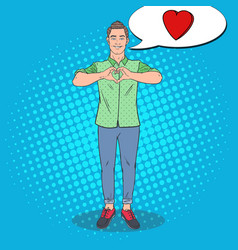 pop art young man showing heart hand sign vector image