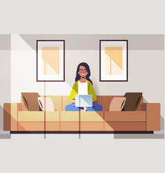Beautiful indian woman sitting on couch using vector