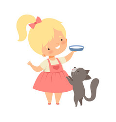 Cute little girl feeding her kitten with milk vector