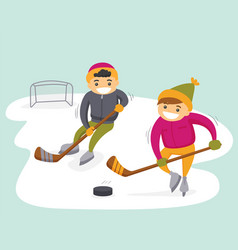 Caucasian boys playing hockey on outdoor rink vector