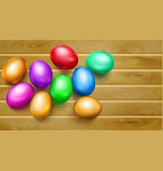 colored easter eggs on wooden planks vector image