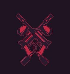 Crossed paintball guns on dark vector