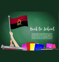 flag of angola on black chalkboard background vector image