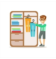 Boy Ranging Clothes In Dresser Smiling Cartoon Kid vector image