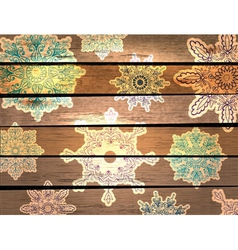 Wood background with beautiful snowflakes vector image vector image