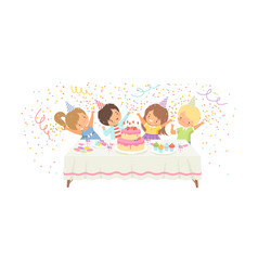 cute boys and girls having fun at festive table vector image