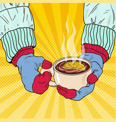 hands in mittens holding cup with hot tea vector image vector image