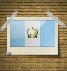 Flags Guatemala at frame on a brick background vector image vector image