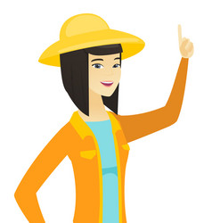 young asian farmer pointing with her forefinger vector image vector image