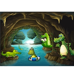 Crocodiles swimming in the cave vector