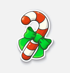 Cartoon sticker with candy cane and ribbon vector