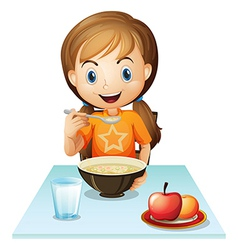 A smiling girl eating her breakfast vector image
