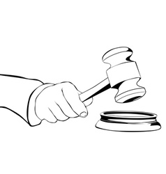 Hand with judicial hammer vector