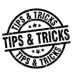 Tips tricks round grunge black stamp vector