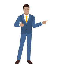 businessman showing thumb up and pointing vector image