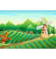 A farm with wooden houses and a scarecrow vector image