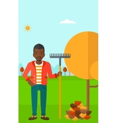 Man with rake near tree and heap of leaves vector