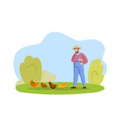 Happy male farmer in overalls feeding chickens vector