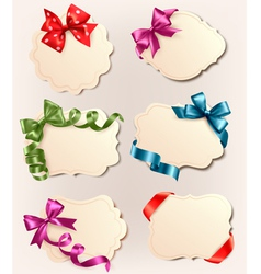set of retro labels with red gift bows and ribbons vector image vector image