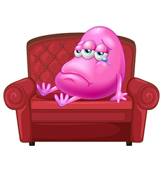 a crying monster sitting on red sofa vector image