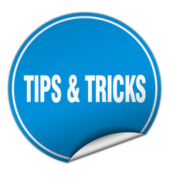 Tips tricks round blue sticker isolated on white vector