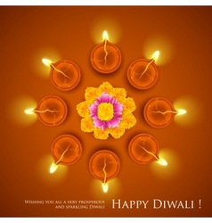 Decorated Diwali Diya on Flower Rangoli vector image