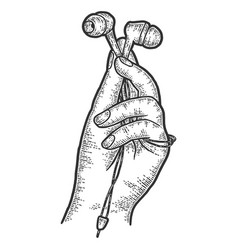A hand holds headphones sketch scratch board vector