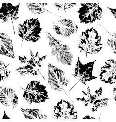 Black and white seamless pattern of falling leaves vector