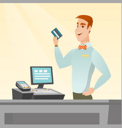 Caucasian cashier holding a credit card vector