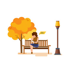 girl resting in autumn park communicates on phone vector image
