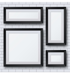 Blank picture frame set on brick wall vector