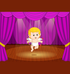 cute little boy wearing cupid costume on stage vector image