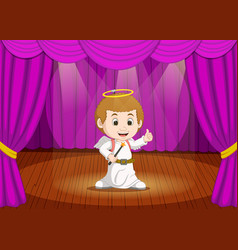cute little boy wearing angel costume on stage vector image