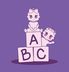 Baby shower card with girls and alphabet blocks vector