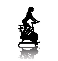 Woman silhouette on exercycle in spinning class vector