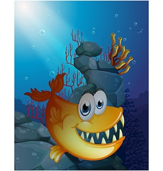 A scary fish under the sea near the rocks vector image vector image