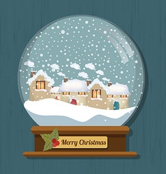Christmas snow globe with beautiful houses in it vector