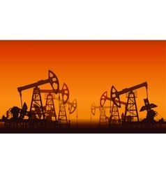 Oil pumps over sunset vector