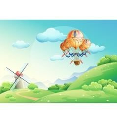 summer fields with a balloon in the sky vector image