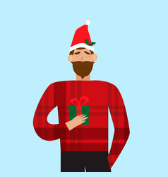 smiling man in santa red hat holding christmas vector image