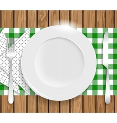 Clean plate with knife fork and napkin on wooden vector