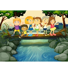 Children having fun by the river vector image
