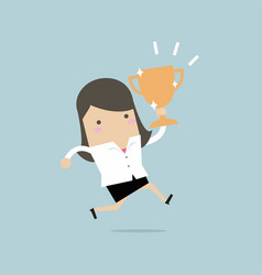 Businesswoman jumping and holding trophy vector