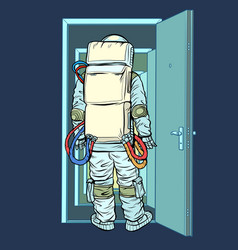 Astronaut stands in front an open door new vector